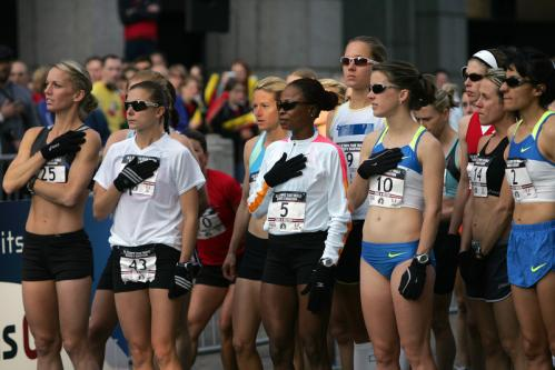Runners stood for the national anthem before the start of Sunday's U.S. Olympic marathon trials in Boston.