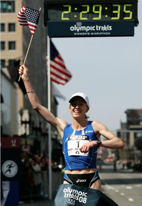 Deena Kastor crossed the finish line as the winner, earning a spot on the U.S. Olympic team for the Beijing games.
