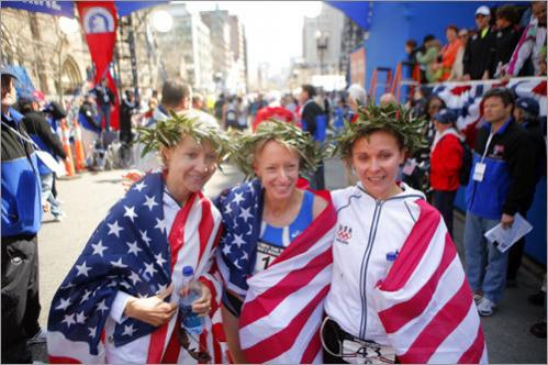 Deena Kastor (center, first place), Magdalena Lewy Boulet (right, second place) and Blake Russell (left, third place) posed after the race.