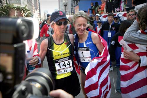 New England running legend Joan Benoit Samuelson (left) and winner Deena Kastor posed after the race.