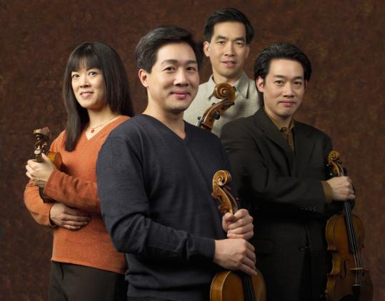 From left: the Ying siblings Janet, Phillip, David, and Timothy have been artists in residence at Harvard since 2001.