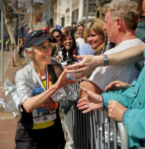 Joan Benoit Samuelson reaches out to fans after setting an American record for her age group.
