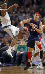 Rajon Rondo dishes off despite the defense of Mike Bibby, whom the Celtic point guard got the better of last night.
