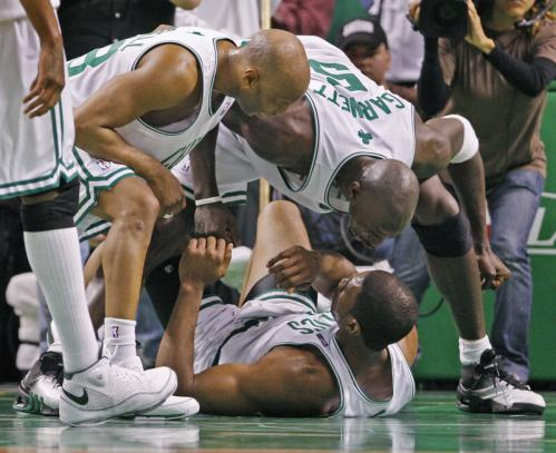The always emotional Kevin Garnett (right) went crazy on Leon Powe (on floor), screaming at him emphatically for making the play.