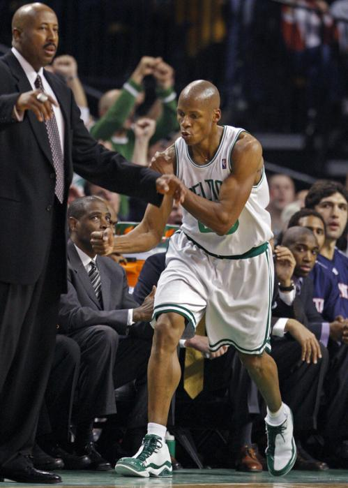 Ray Allen pumps his fist as he brings Hawks head coach Mike Woodson (left) out of his seat to call a timeout after Allen hit a shot to put Boston ahead 60-44 in the third quarter.