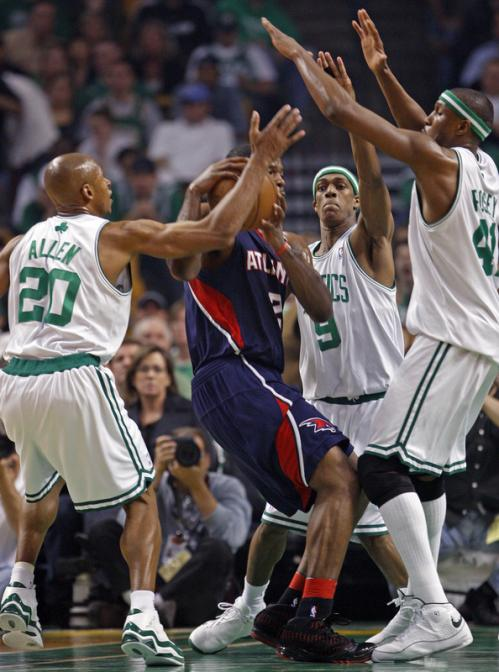 Ray Allen (20), Rajon Rondo (9), and James Posey surround the Hawks' Joe Johnson.