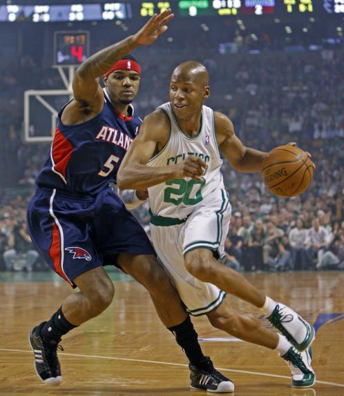 Ray Allen (20) drives against the Hawks' Josh Smith during first-quarter action.