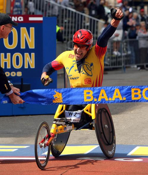 Men's wheelchair division winner Ernst Van Dyk crosses the finish line.