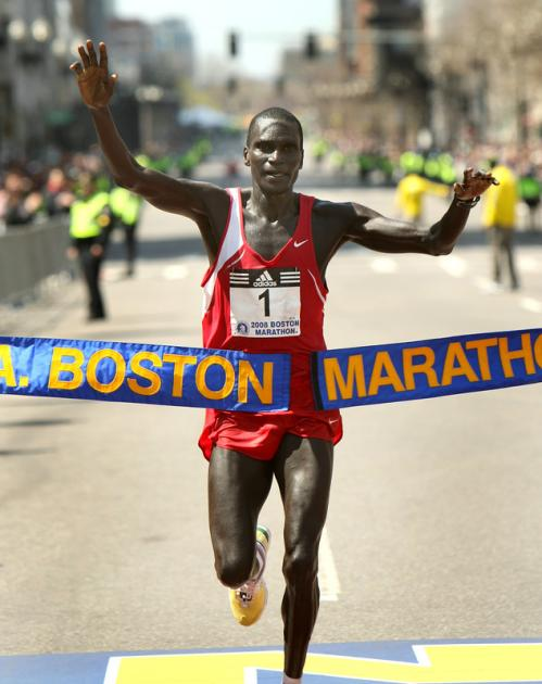 Robert Cheruiyot from Kenya breaks the tape to win the men's race.