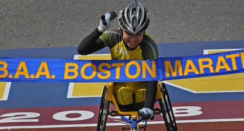 Women's wheelchair winner Wakako Tsuchida crosses the finish line.