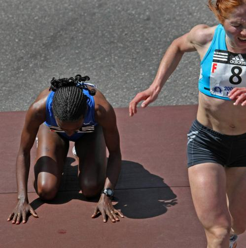 Women's chamion Dire Tune from Ethiopia kneels on the ground after edging Alevtina Biktimirova from Russia.