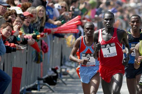 Boston Marathon men's winner Robert Cheruiyot passes through Newton.