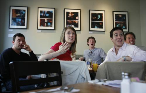 (From left:) Adam Jaroszewski of Allston, Justine Simisky of Malden, Spencer Coan of Branford, Conn.; Ryan Whalen of Brighton; and Ben Coan of Brighton watch women's champion Dire Tune race to the finish while eating lunch at Z Square Restaurant near Kenmore Square.