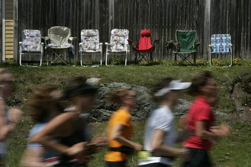 At approximately the 16-mile mark on Washington Street, runners go past empty spectator chairs during the lunch hour.