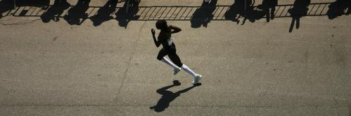 Magdaline Chemjor of Kenya races through Kenmore Square.