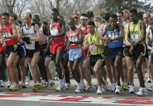 Timing is everything, even at the start for the men's elite field, which included eventual winner Robert Cheruiyot (No. 1, third from left).