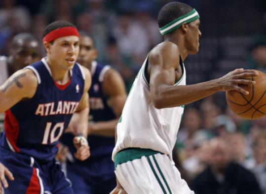 Mike Bibby tries to check Rajon Rondo in Game 1, but it was easier said than done as Rondo had 15 points and nine assists.