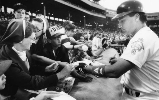 John Marzano, signing autographs before a game at Fenway.