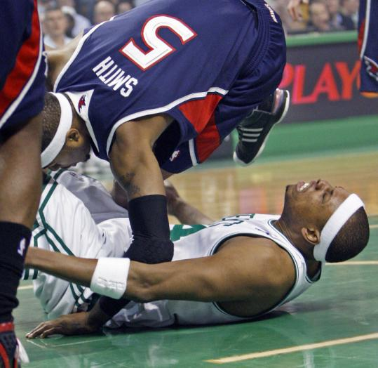 Paul Pierce strained his lower back getting tangled up with Josh Smith in the first quarter. Pierce left briefly, but returned.