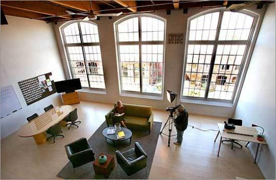 At a temporary production studio in Cordage Park, Plymouth Rock Studios has set up executive offices and is filming a 'reality sitcom.'