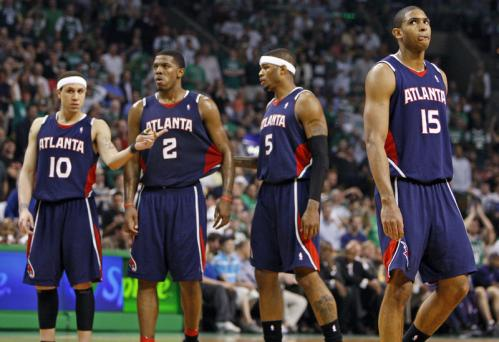 The expressions of the Hawks (left to right) Mike Bibby, Joe Johnson, Josh Smith, and Al Horford seem to indicate they know the game is over as they come back onto the floor following a fourth-quarter timeout.