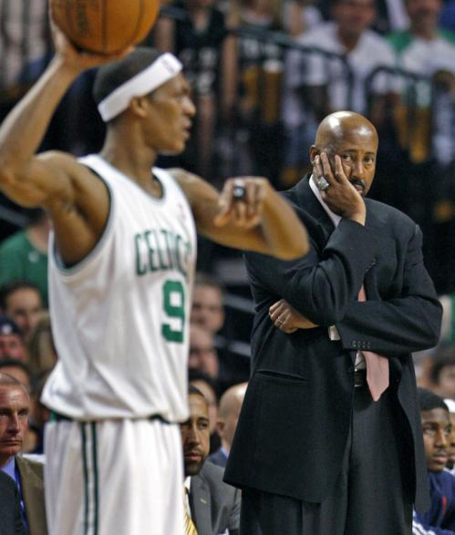 Atlanta head coach Mike Woodson doesn't look too happy as he watches the Celtics' Rajon Rondo (9) look for an open man in the fourth quarter.