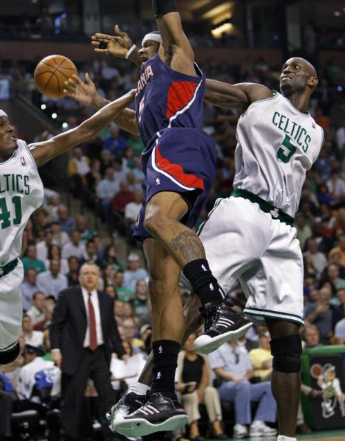 Boston's James Posey (left) received a foul call for this drag down of the Hawks' Josh Smith, with the help of Kevin Garnett (5).