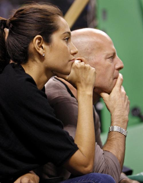 Seen in the crowd at the Celtics-Hawks game at the TD Banknorth Garden tonight were actor Bruce Willis (right) and his girlfriend Emma Heming.