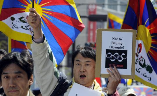 A pro-Tibet demonstrator shouted during a march in Nagano, Japan, yesterday. The Olympic flame will arrive on Chinese soil on May 2 in Hong Kong, for a long journey around the country.