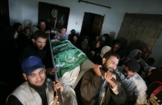 Mourners carried the body of Mariam Marouf, the 14-year-old daughter of Hamas militant commander Talat Hassan Marouf, during her funeral in Beit Lahiya, Gaza Strip, yesterday. The military said Israeli troop