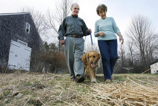 Lee and Jane Quimby, with their dog Jake outside their home in Center Sandwich, N.H. The couple want to simplify their finances.