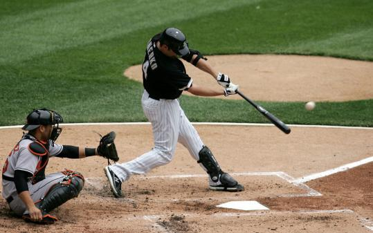 Paul Konerko connects on the first of his two home runs. The White Sox first baseman entered yesterday's game hitting just .197 with three homers.