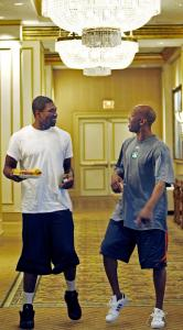 After sitting through a film review of their Game 3 loss, Celtics players Leon Powe (left) and Sam Cassell try to work out the kinks in the lobby of their Atlanta hotel.