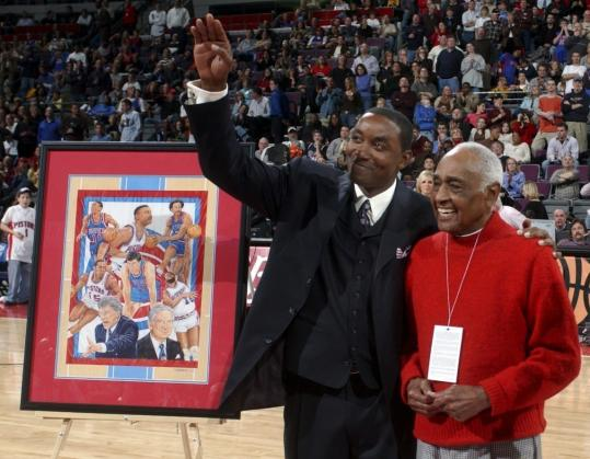 Former Pistons' star Isaiah Thomas (left) honors Will Robinson at a Pistons game. Mr. Robinson was the first black coach in Division I college basketball.