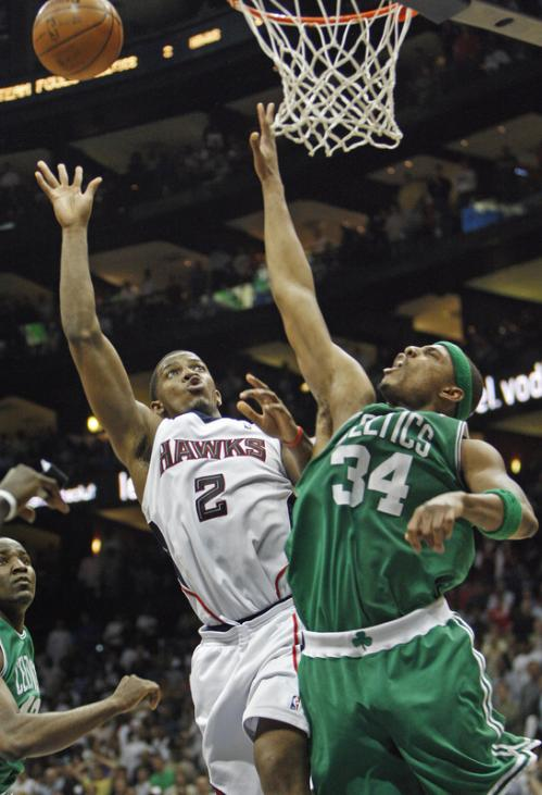 Atlanta's Joe Johnson (2) drives on Boston's Paul Pierce.