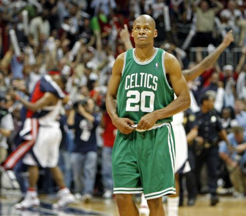 Atlanta players and fans celebrate in the background as Celtics guard Ray Allen walks off the court.
