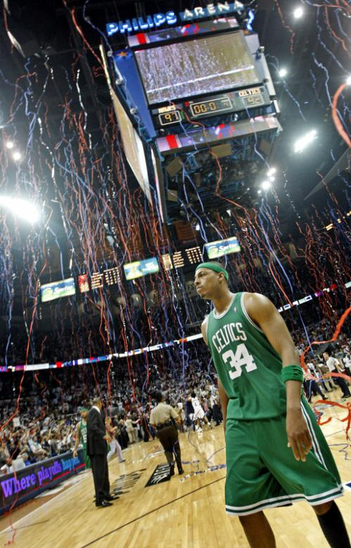 Confetti steams from the rafters as Paul Pierce walks off the court following Atlanta's 97-92 win over the Boston Celtics in Game 4 of a first-round playoff series.