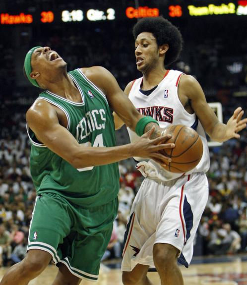 Boston's Paul Pierce (34) tries to draw a foul on Josh Childress.
