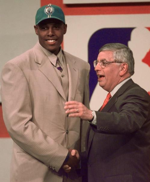 Paul Pierce (left) was congratulated by NBA Commissioner David Stern after being drafted 10th in the first round of the NBA draft by Rick Pitino's Boston Celtics. Pierce averaged 16.4 points and 6.3 rebounds per game in his three seasons at Kansas, earning MVP honors in the Big 12 Conference Tournament in both 1997 and 1998.