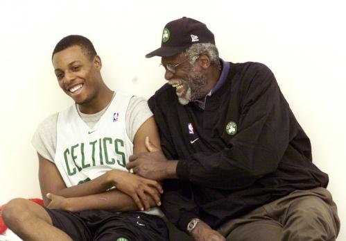 Paul Pierce and Celtics legend Bill Russell at a team practice. During the 2000-2001 season, Pierce scored 20-plus points 60 times and grabbed five-plus rebounds 58 times.