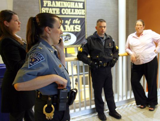 Lieutenant Pam Curtis, with Framingham State College's campus police force, coordinating security in preparation for Governor Deval Patrick's arrival for a ceremony last year.