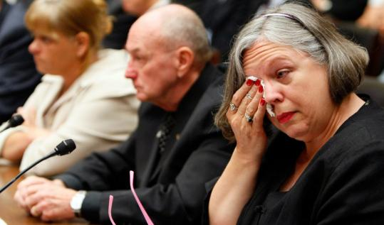 Johanna Marie Staples weeps as she testifies to Congress about her husband's death following a reaction to heparin.