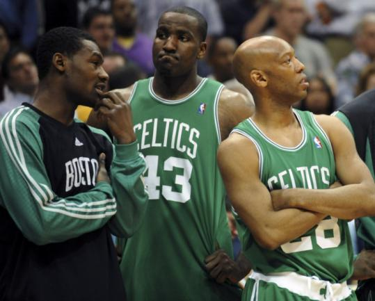 Tony Allen, (left) Kendrick Perkins (center), and Sam Cassell watched as Joe Johnson ran all over the Celtics in Game 4.