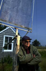 Bob Cunningham, outside the one-person hut in New Brunswick, Canada, where most of his research on fog took place. The structure behind him is known as a fog catcher.