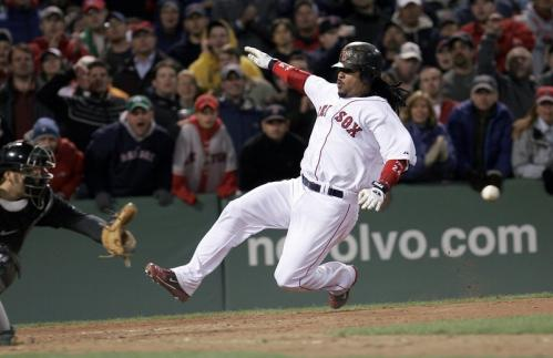 Boston Red Sox left fielder Manny Ramirez beats the throw to the plate for the winning run as the Red Sox topped Toronto, 2-1.