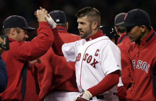 Red Sox captain Jason Varitek is congratulated by teammates following his winning RBI single in the ninth inning.