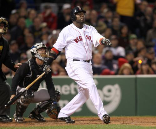 Red Sox slugger David Ortiz watches his home run in the seventh inning.