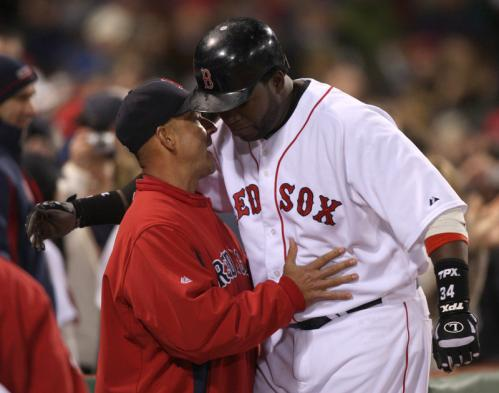 Red Sox manager Terry Francona embraces David Ortiz in the dugout after Ortiz's home run in the seventh inning.
