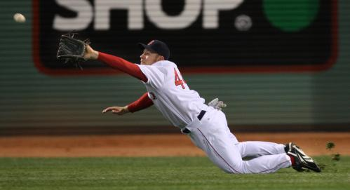 Red Sox right fielder Brandon Moss dives to make a catch on a line drive by Alex Rios in the eighth inning.