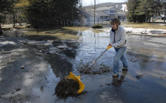 'I realize there are some people worse off than us,' Christine Chasse said as she removed debris from her driveway after water receded in Fort Kent, Maine.